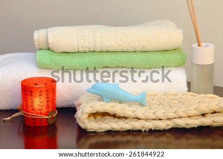Towel stack with bast and dolphin form soap in the shower. - stock photo