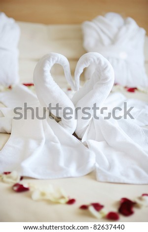 Towel swans left by a hotel room service