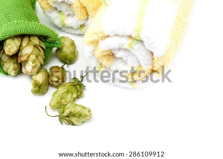 Towels and hop isolated on white background. Spa setting. - stock photo