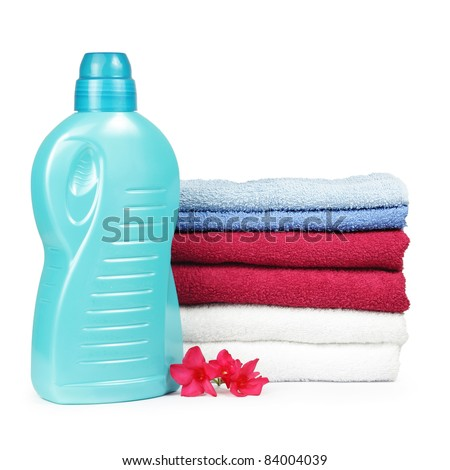 Towels and liquid laundry detergent with oleander flower - stock photo