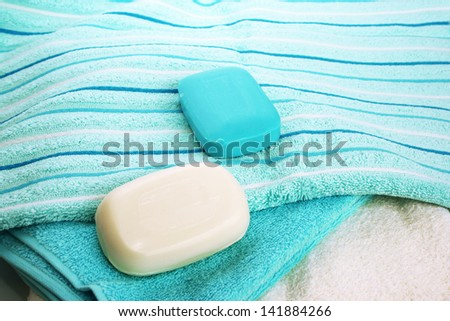 Towels and soaps closeup picture.