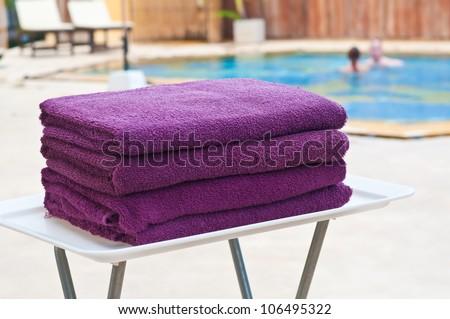 Towels at swimming pool - stock photo
