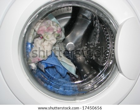 Towels being rinsed in  laundry washer