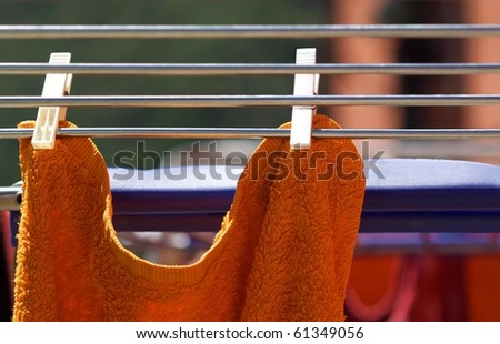Towels drying on the clothesline (detail). - stock photo