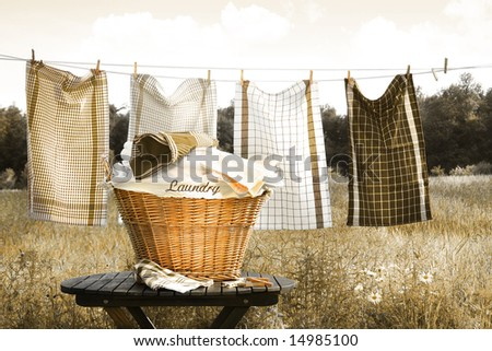 Towels drying on the clothesline with laundry basket/ Selective color - stock photo