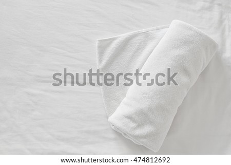 towels on bed sheet