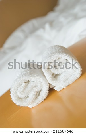 towels on table in a hotel room - stock photo