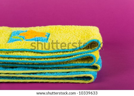 Towels on the purple background
