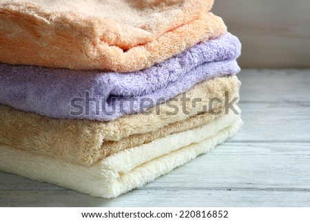 Towels on wooden boards, closeup - stock photo