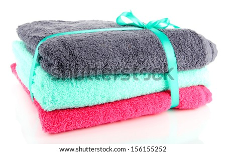 Towels tied with ribbon isolated on white - stock photo