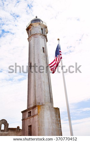 Tower and USA flag in Alcatraz - stock photo
