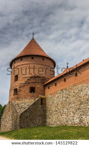 Tower and wall of the Trakai red brick castle in Lithuania