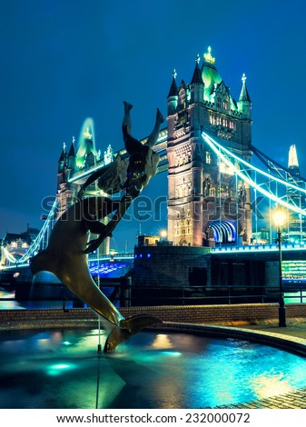 Tower Bridge and St Katharine Docks Girl with a dolpin fountain - stock photo