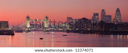 Tower Bridge and the City of London as viewed at sunset along the Thames
