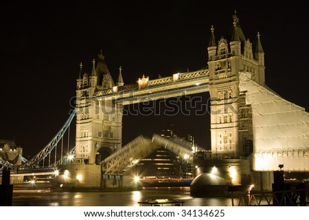 Tower Bridge at night, with a blur of the road closing - stock photo