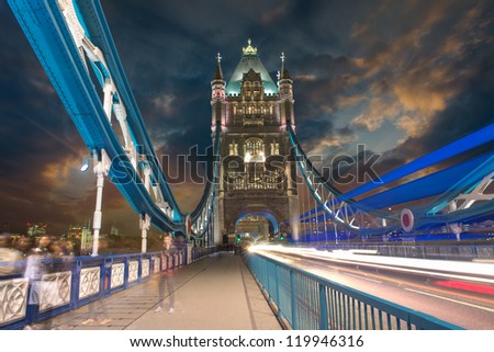 Tower Bridge at Night with car light trails - London. - stock photo