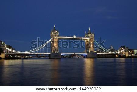 Tower Bridge in London, England at night - stock photo