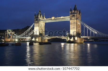 Tower Bridge in London in the evening with reflection - stock photo