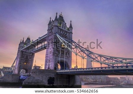 Tower Bridge in the evening with  violet sunset. London, England.