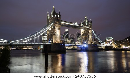 Tower Bridge, in Tower Hamlet, part of London, at dusk   - stock photo