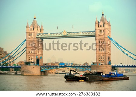 Tower Bridge in yellow tone in London over Thames River as the famous landmark. - stock photo