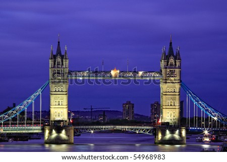 Tower Bridge is a combined bascule and suspension bridge in London, England, over the River Thames. It is close to the Tower of London, which gives it its name and become an iconic symbol of London.