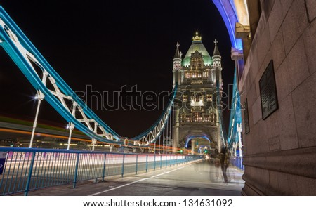 Tower Bridge, London with blurred traffic and pedestrians - stock photo