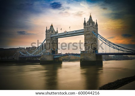 Tower Bridge on dramatic sky at London, UK