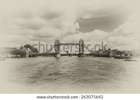Tower Bridge over River Thames - iconic symbol of London. It is a combined bascule and suspension bridge. Tower Bridge is close to Tower of London, from which it takes its name. Antique vintage. - stock photo