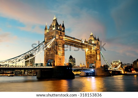 Tower Bridge over Thames River at dusk in London - stock photo