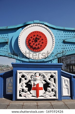 Tower Bridge structural detail above decorative panel with St George's cross and Latin motto 'Domine Nos Dirige', meaning 'Master Guide Us', built from 1886 to 1894, London, UK. - stock photo