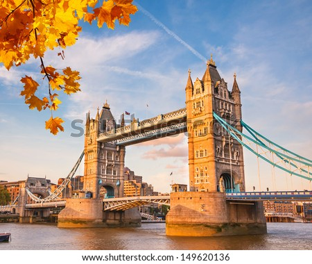 Tower bridge with autumn leaves, London - stock photo