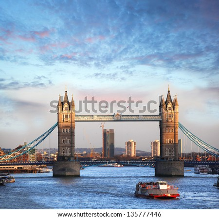 Tower Bridge with boat on river in London, UK - stock photo