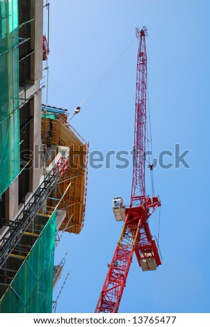 Tower crane and house-building - stock photo
