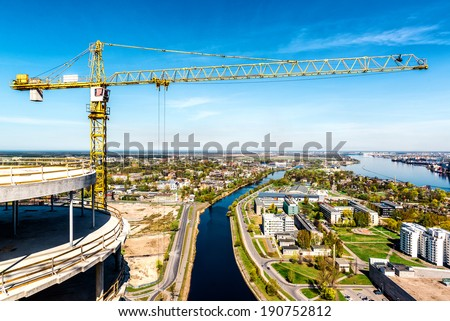 Tower crane in construction site. Riga city, Latvia  - stock photo