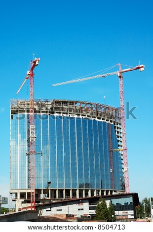 Tower cranes make skyscraper - stock photo