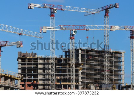 tower cranes on the construction of the building  - stock photo