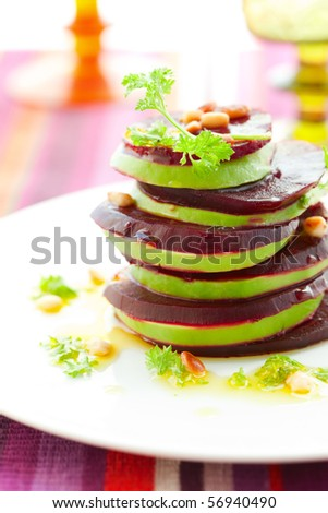Tower of beetroot and avocado with pine nut - stock photo