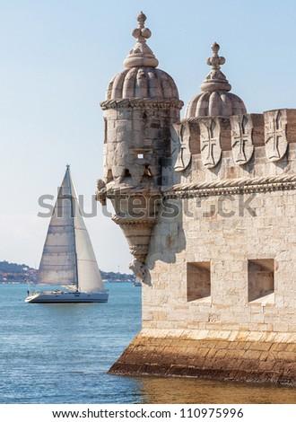 Tower of Belem ( Torre de Belem ) and white yacht - Lisbon - stock photo