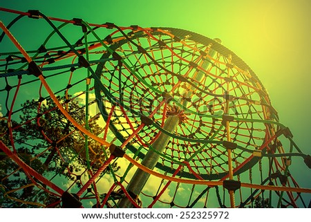 Tower of colored ropes, built for children to play. - stock photo