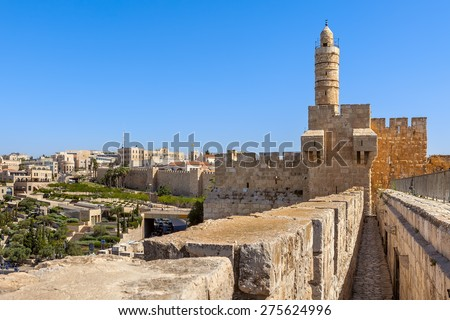 Tower of David and ancient citadel under blue sky as Mamilla neighborhood on background in Jerusalem, Israel. - stock photo