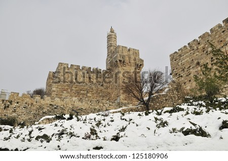 Tower of david, old city walls of Jerusalem rare snow - stock photo