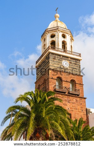 Tower of famous church Nuestra Senora de Guadalupe in Teguise town, Lanzarote island, Canary Islands, Spain - stock photo