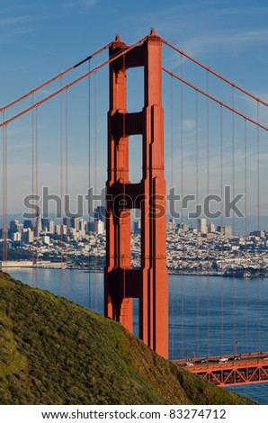 Tower of Golden Gate Bridge with San Francisco cityscape - stock photo