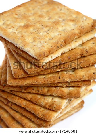 Tower of integral crackers on white background