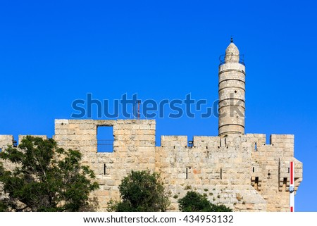 Tower of King David over old city walls of Jerusalem - stock photo