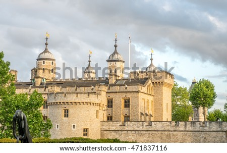 Tower of London, the strong fortress near river Thames in London, England, under cloudy evening sky