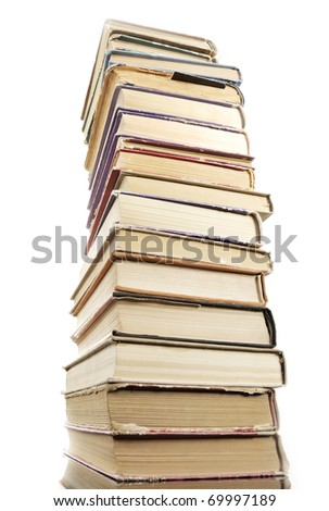 Tower of old  books on white background, arranged in stack.