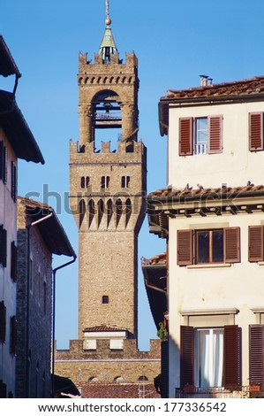 Tower of Palazzo Vecchio view from Santa Croce square, Florence, Italy - stock photo