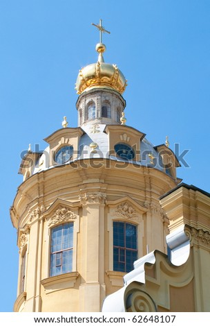 Tower of Peter and Paul Fortress against blue sky. St. Petersburg, Russia
